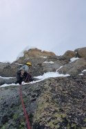 Climbing the slab to retrieve the rope